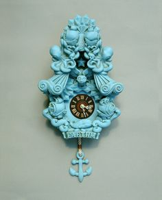 An absolutely stunning work of art.  I will be saving my pennies to purchase this clock. It's something made of dreams and fairy tales. Faethm Cuckoo Clock wall clock art sculpture Turquoise Robins Egg Blue by Marisol Spoon. $295.00, via Etsy.