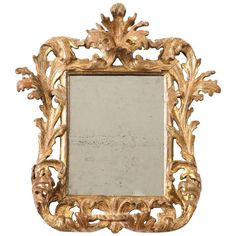 Italian Baroque Carved and Gilded Mirror | From a unique collection of antique and modern wall mirrors at https://www.1stdibs.com/furniture/mirrors/wall-mirrors/
