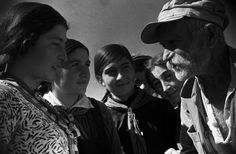 Ancient Mr. Gvianishvili speaking with children, 1937. He was 125 years old, a confederate of Arsen of Tbilisi in the early 19th century. Georgia