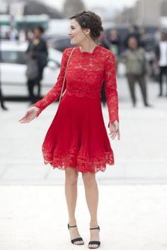 Très Chic! The Best Street Style at Paris Fashion Week: High-shine brocade gave this suiting a more dramatic finish.  : A sleek white coat got a femme twist with a bow-tied waist.  : Red leather livened up a classic trench.  : The prettiest fiery-red lace dress with the romantic hair to match.