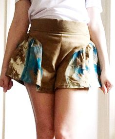 An item from my collection of clothes made during university, these tan colour faux suede cullotte style shorts have a turquoise and cream feather print, printed using the silk screen printing method. An individual one off piece with a button up back - these are one of my favourite pieces from my collection Cullottes, Feather Print, Silk Screen Printing, Short Dresses, Suede Shorts, Turquoise, My Favorite Things, Printed, Fashion Bloggers