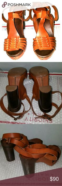 "Barneys NY strappy sandals cognac upper 4.5"" wood heel, 1 1/4"" front platform. Cognac leather upper. Ankle strap/buckle closure. Never worn. I purchased on Barneys Warehouse website a few years ago. They run extreme small...but I couldn't return since they were on final sale. I paid close to $200.00. They measure 10 3/4"" in lenght and 3 1/4"" across the widest point of the sole. Size 41 but I would say they are size 9 ( a friend who is size 9 tried them on). Made in Italy. Barneys New York…"