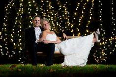 twinkling lights bride and groom wedding backdrop
