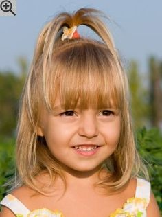 Cute hairstyle for little girls. Over the shoulders long hair with the crown styled into a fountain.