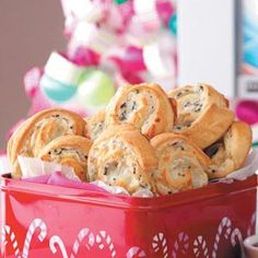 Crab 'n' Cheese Spirals Recipe from Taste of Home -- These pretty pinwheels are loaded with cheese, imitation crabmeat and black olives. —Lisa Harke, Old Monroe, Missouri
