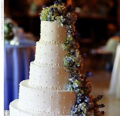 Cathy and Keith cut a wedding cake decorated with cascading blue hydrangeas. The white chocolate cake boasted champagne Italian cream and Chambord filling.