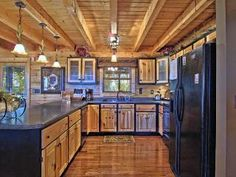 large well stocked kitchen with breakfast bar