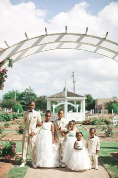 Cutest flower girls and ring bearers ever with this garden wedding ceremony!