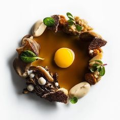 Roasted royal trumpet mushrooms roasted hen of the woods mushrooms pickled chanterelle mushrooms pickled enoki mushrooms glazed shitake mushrooms glazed oyster mushrooms pine nut purée cooked barley teff chip nasturtium purslane and fried quail egg with mushroom sauce by @danielhumm. Tag your best plating pictures with #armyofchefs to get featured. ------------------------ #foodart #foodphoto #foodphotography #foodphotographer #delicious #instafood #instagourmet #gastronomy #foodporn…