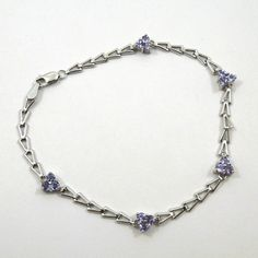 3 Round Cut Tanzanite Cluster 14K White Gold Bracelet, featuring an intricate chain.  - $215