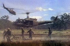 """UH-1 aircraft of the 229th Assault Helicopter Battalion, carry wounded 1st Battalion, 7th Cavalry Soldiers away during the fight for LZ X-Ray in the Ia Drang Valley of Vietnam.  Photo extracted from US Army motion picture footage. (Nov 1965)"""""""