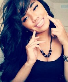I love the side bangs and the dark color, beautiful and it brings out her eyes and skin undertones.