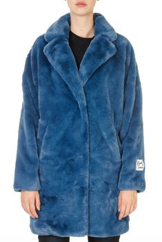 This is the 'Joela' Mirage Blue Faux Fur Coat by our friends at Rino & Pelle! A gorgeous piece to layer over your outfit giving it that finishing touch. In a super soft faux fur with a long length fit, this Joela coat can be worn for any occasion to make heads turn. Winter Coats Women, Faux Fur, Shop Now, Fur Coat, How To Make, Jackets, Blue, Touch, Outfits