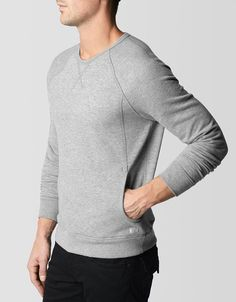 Slick athletic crewneck sweatshirt; a contemporary riff on a classic style.