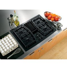 """View the GE PGP989 Profile 30"""" Built-In Gas Downdraft Cooktop with Sealed Burners at Build.com."""