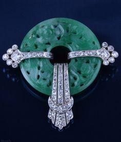 An Art Deco platinum, diamond and jade brooch, French, circa 1930. #ArtDeco #brooch