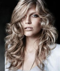 Long curly hairstyle for women. This styles can be described as romantic, feminine, stylish and sexy