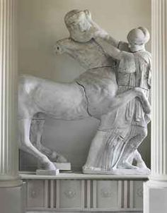 A PLASTER MODEL OF A CENTAUR AND A LAPITH MAIDEN FROM THE WEST PEDIMENT OF THE TEMPLE OF ZEUS LATE 19TH CENTURY, AFTER THE ANTIQUE