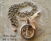 Vintage pocket watch Necklace with Frozen Charlotte Doll on Pearl Chain