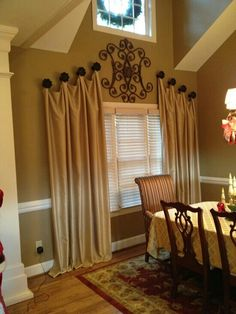 Hanging curtains at an angle adds interest. The contrasting big knobs draws attention to the angle.