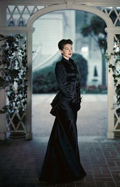 Ava Gardner color photo movie star hollywood glam long black dress gown silk satin peplum bustle long sleeves dress undo hairstyle let 40s early 50s vintage fashion style evening wear
