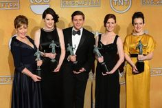 """Actors Phyllis Logan, Michelle Dockery, Allen Leech, Amy Nuttall and Sophie McShera (L-R), winners of Outstanding Performance by an Ensemble in a Drama Series for """"Downton Abbey"""", appear backstage with their awards at the 19th annual SAG Awards held at the Shrine Auditorium in Los Angeles on January 27, 2013. UPI/Jim Ruymen"""