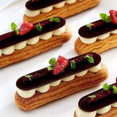 Another great shot of eclairs by - Caramelised hazelnuts, raspberry gel, chocolate creme diplomat, Greek yoghurt ganache and coffee jelly. Elegant Desserts, Cute Desserts, French Desserts, Beautiful Desserts, Gourmet Desserts, Dessert Recipes, Plated Desserts, Mini Cakes, Cupcake Cakes