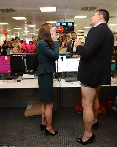 The Duchess of Cambridge met trader Nigel Halligan, who dressed as a woman, as she and Pri...