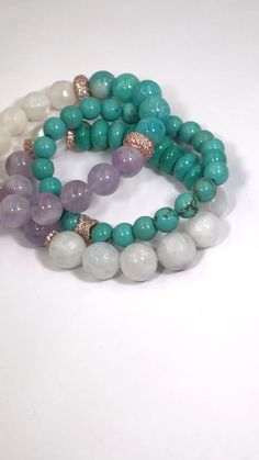 Such pretty colors together! Turquoise beads mix with lavender quartz and white moonstones accented by rose gold pave cz beads to create this elegant bracelet stacking set. Perfect for year round wear. Handmade Bracelets, Earrings Handmade, Handmade Jewelry, Beaded Bracelets, Custom Jewelry, Tiny Earrings, Bead Jewelry, Modern Jewelry, Stone Jewelry