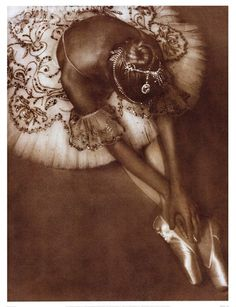 Ballerina wearing a lovely embroidered tutu.