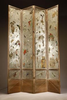 An Art Deco 'Japanese' style decalcomania, silver paper and mirror four-panel floor screen.