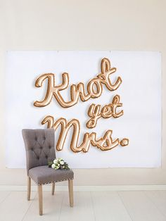 """This rose gold balloon letters backdrop is perfect for a bridal shower or bachelorette party, and reads """"knot yet mrs."""""""