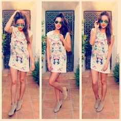 Shay Mitchell's pretty printed dress and mirrored sunglasses