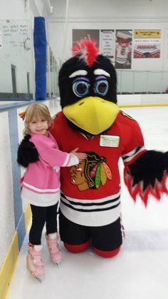 A little Blackhawks fan with Tommy Hawk!