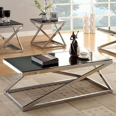 "SKU cm4813 Contemporary design group coffee table, end tables. This design group combines ""Z"" tubular metal, chrome, metal table base with black glass tops."
