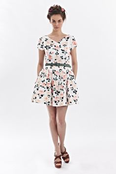 """Mrs Pomeranz """"Rosa"""" dress features a fitted upper bodice with a subtle V-neck. A…"""