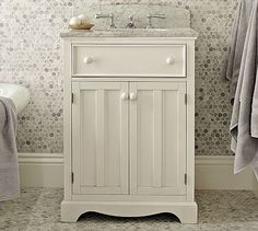 Lucca Single Mini Sink Console #potterybarn I waffle between a pedestal sink and a typical bathroom vanity. This one is a) currently on sale, b) includes the top and sink (which not all vanities do!) and c) is classic and timeless.