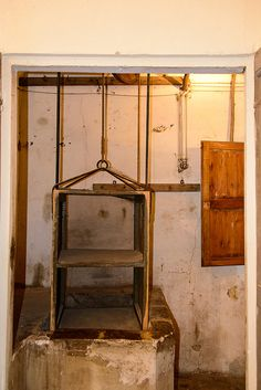 Dumbwaiter a small elevator used to convey food or other goods