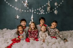holiday mini session photo shoot christmas pajamas bed siblings friends large group kids silver hanging stars blue backdrop puffy cotton clouds Holiday Mini Session, Mini Sessions, Cotton Clouds, Hanging Stars, Bucks County, Christmas Pajamas, Boudoir Photographer, Siblings, Photo Shoot