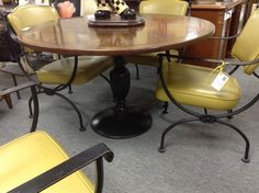 Dining Set - Mid century dining set.  Wrought iron chairs and iron table base with wood top..  Includes 4 chairs.  Excellent condition.  Item 362-8.  Price. $370.00    - http://takeitorleaveit.co/2014/03/29/dining-set/