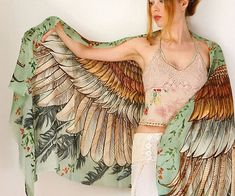 Accent your outfit with the wings scarf and create the illusion you've sprouted a pair of glorious wings overnight. The majestic feather wing design on the scarf is accented by a stunning vintage green backdrop great for complementing a variety of looks.