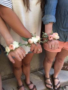 Wrist corsages done in a modern wire bracelet style