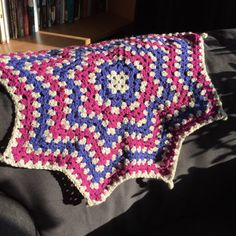 Contemporary baby girl Moses basket, or pram crochet afghan. Star shaped in pink and blue acrylic yarn. Perfect for a baby shower gift or a