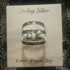 Sterling silver 3 ring set! New With Tags! This is a beautiful set of 3 sterling silver rings that can be worn separately or together! The silver is etched with squiggles and hearts and stars on the outside; each ring has one word etched on the inside making a combination of love...peace...joy! Brand new, never worn, size 8! Jewelry Rings