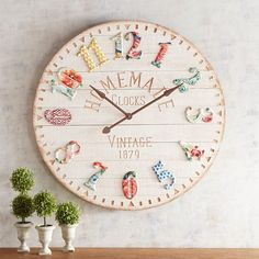 Our oversized, vintage-style clock is both a timekeeper and a style statement with its planked fir base and colorful, wrought-iron numbers.