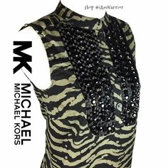 Michael Kors animal print beaded sleeveless tunic Gorgeous sleeveless cotton tunic from Michael Kors just added to closet! Has olive and black animal print with black beaded bib style neckline. Great condition. Super chic MICHAEL Michael Kors Tops Tunics