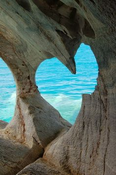 SHAPE this photography shows literally a natural shape. It is a shoot of a rock wall somewhere besides the ocean and one hole inside the rocks is amazingly shaped like heart. The light turquoise of the ocean makes this shape even more visible. Beautiful World, Beautiful Places, Simply Beautiful, Beautiful Pictures, Beautiful Hearts, Beautiful Ocean, Beautiful Scenery, Beautiful Landscapes, The Ocean