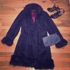 Gorgeous faux fur trimmed black winter coat Only worn a few times beautiful, warm, faux fur trimmed black winter coat. Perfect for special occasions! Collar, sleeves and bottom black faux fur, polyester and acrylic. Faux front pockets Giacca Jackets & Coats Trench Coats