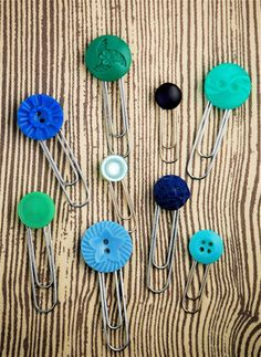 Button Clips - paper clips hot glued to buttons. Could be used as bookmarks.
