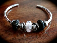 Pink ornament with lavastones on a  Trollbeads bangle by Melanie at Trollbeads Gallery Forum